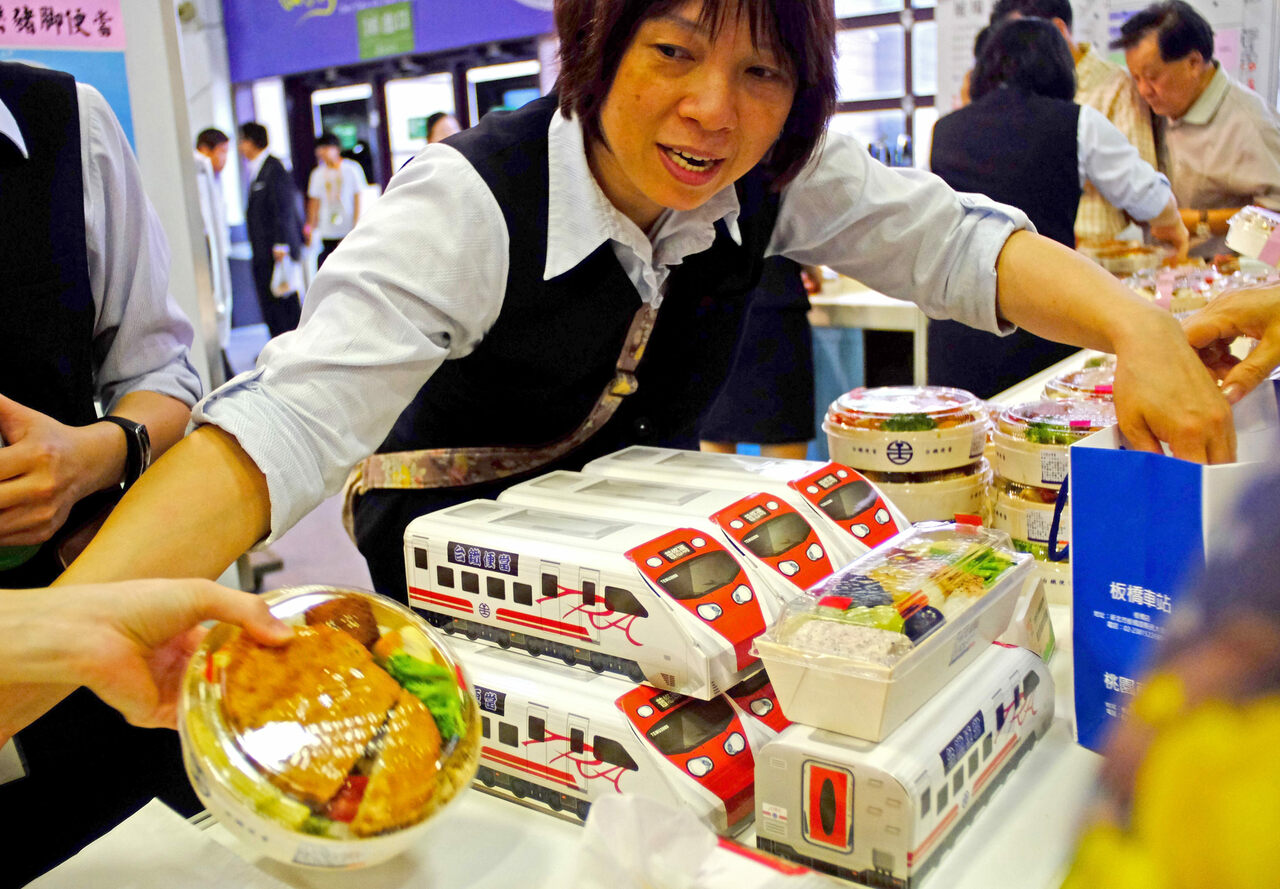 Taiwan Railway staff sorts out lunch boxes at the 2016 Taiwan Culinary Exhibition in Taipei.