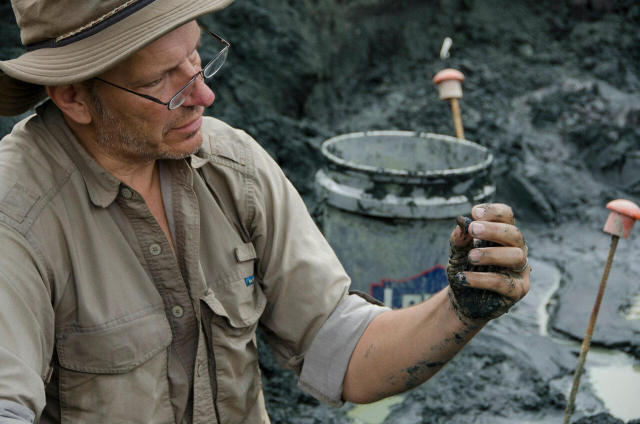 Paleontologist Ken Lacovara excavating in Mantua Township.