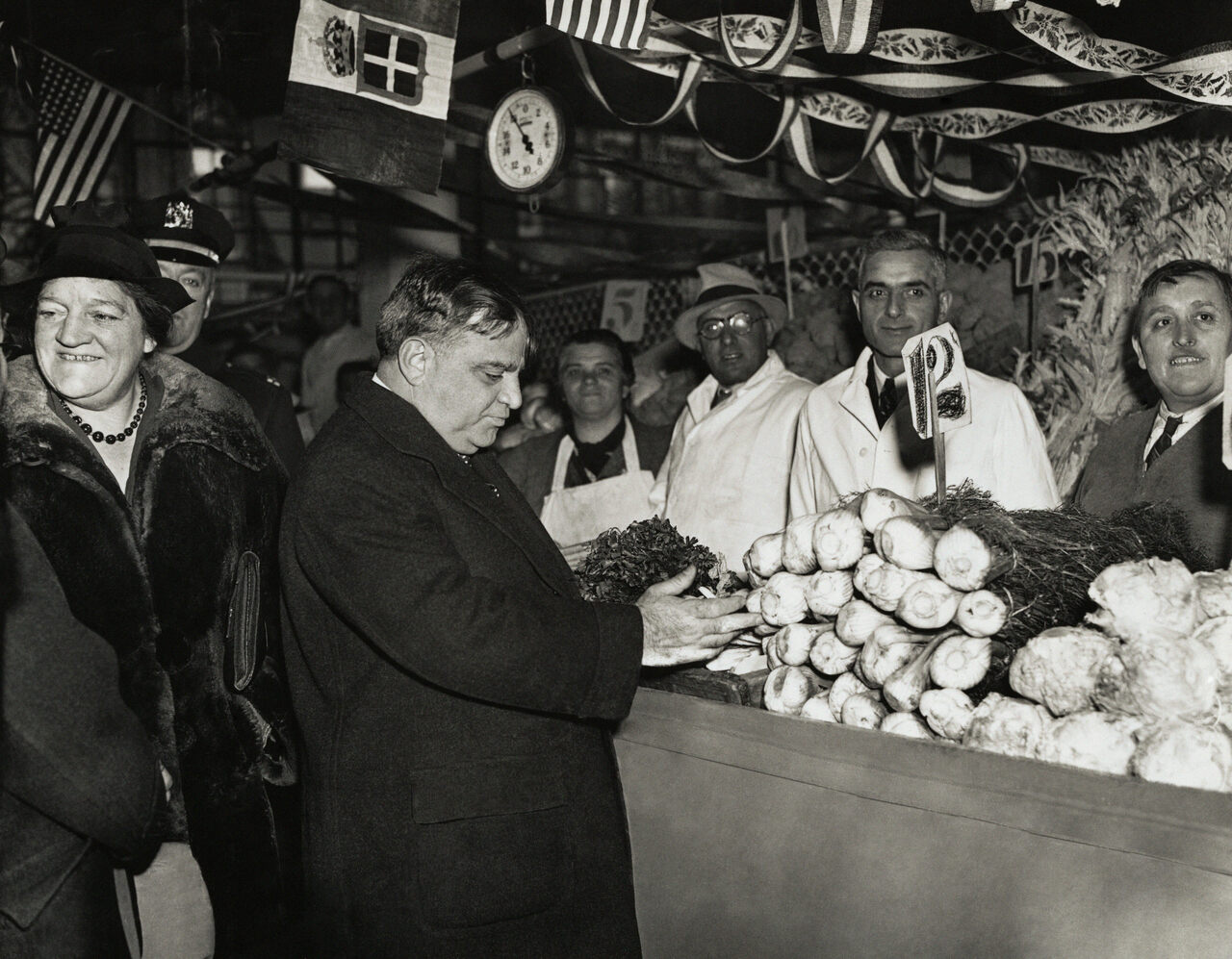 Mayor Fiorello LaGuardia examines produce at a stall several years after his artichoke war.
