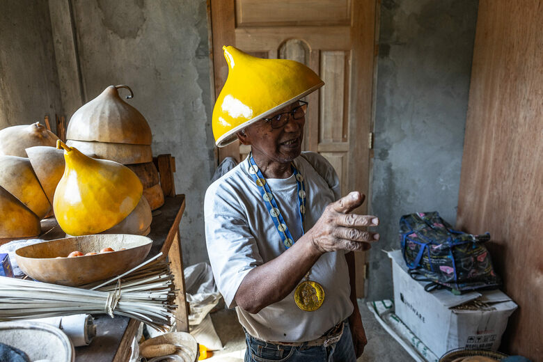 The Man Making Hats Out of Vegetables