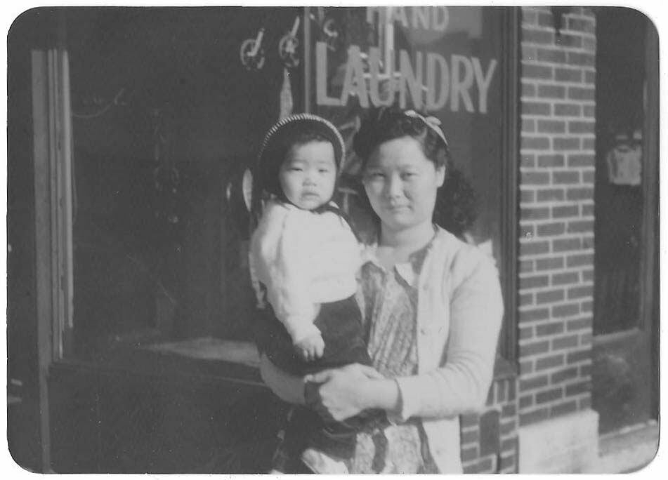 Alice Lee Hum with her mother Jean, at a laundry on 21st Ave in Astoria, Queens, c. 1951.