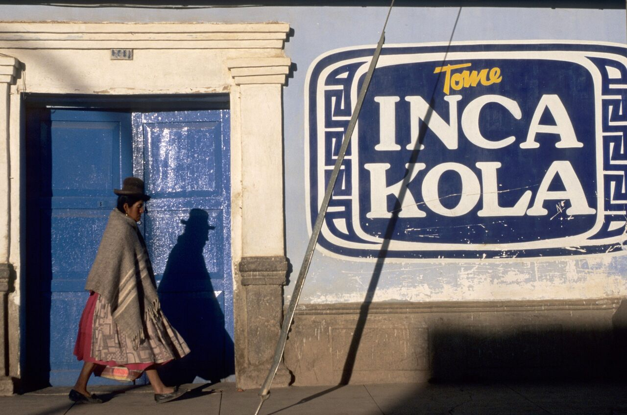 "The sign reads ""Drink Inca Kola."""