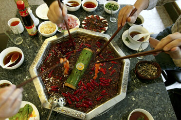 Customers eat hot pot at a restaurant in Chengdu, China.