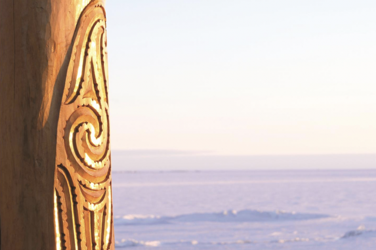 A carved post, or <em>pouwhenua</em>, erected at New Zealand's Scott Base in 2013, overlooks the Ross Ice Shelf in Antarctica.