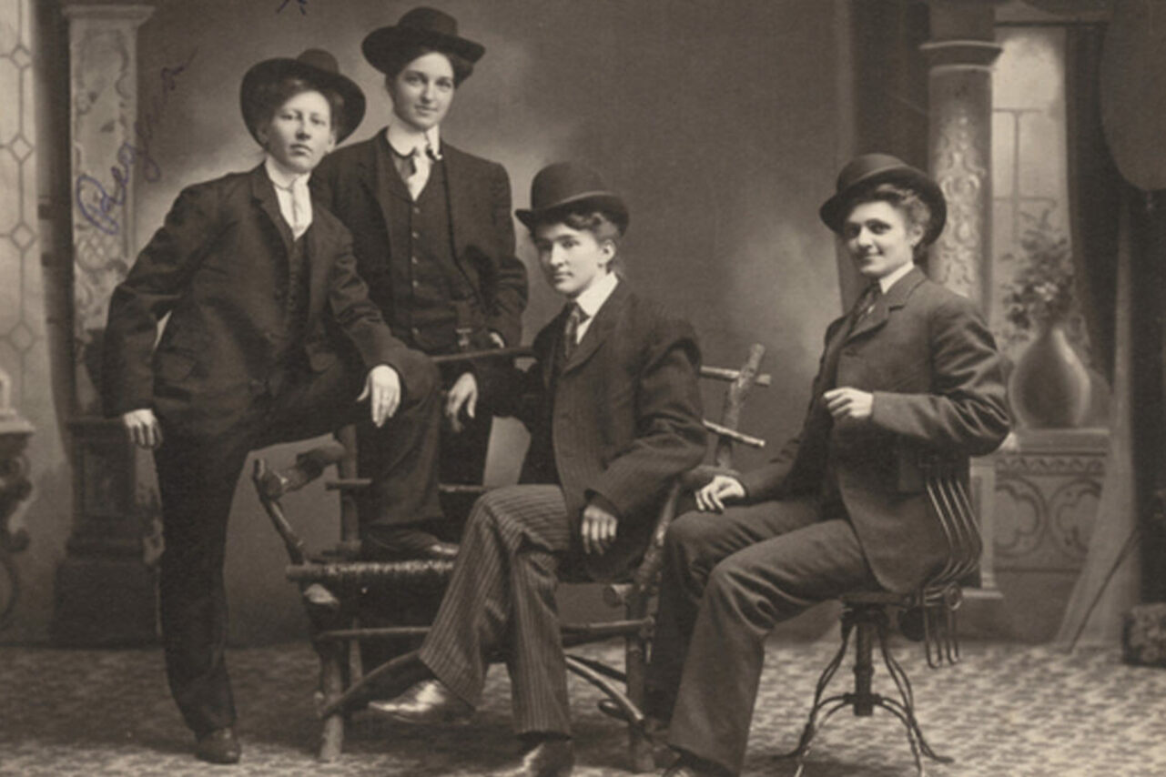 "This photo, taken on the Minnesota frontier, depicts Regina Sorenson and three others ""dressed in men's suits."""