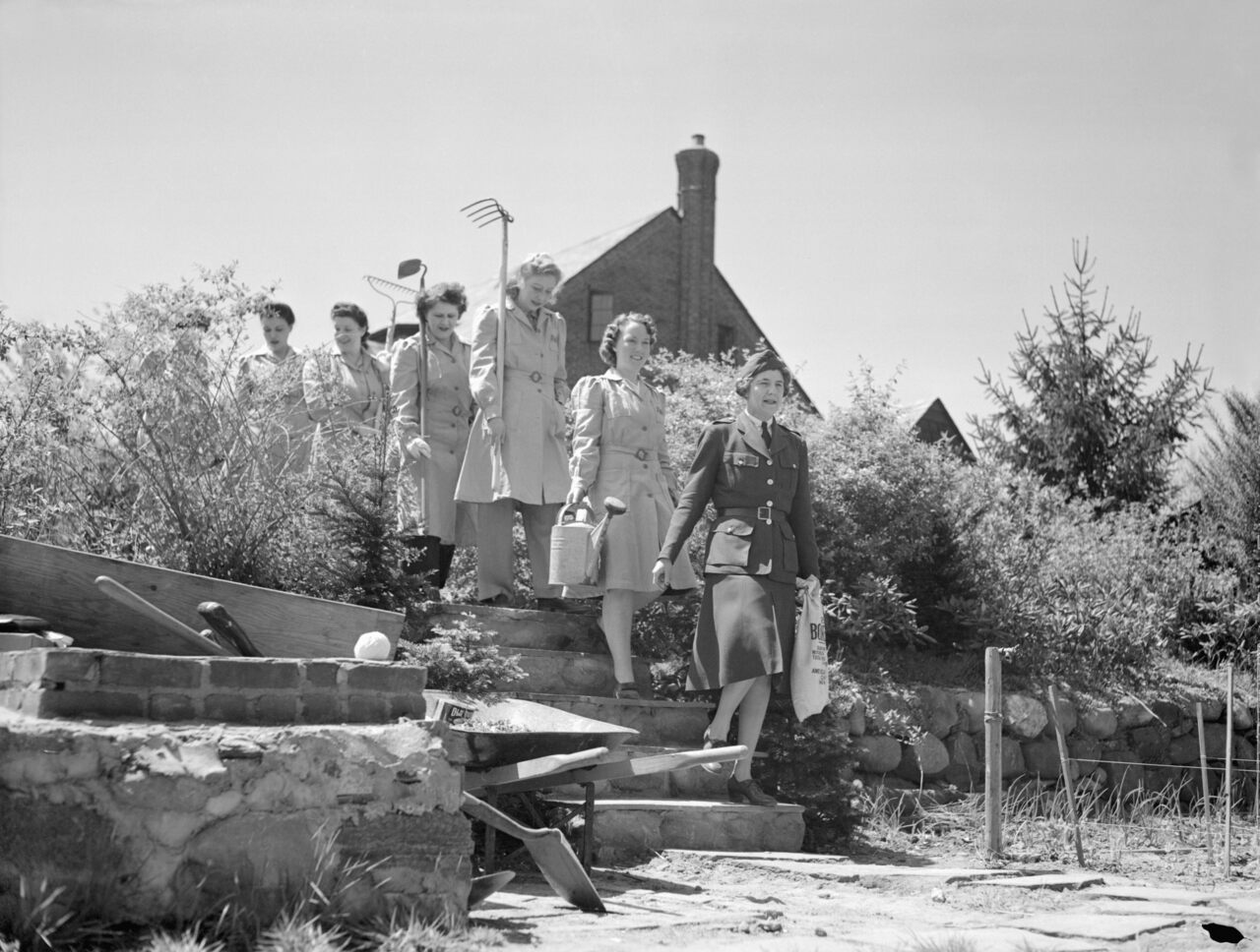 Members of a women's volunteer service in Flushing march into their Victory Garden.
