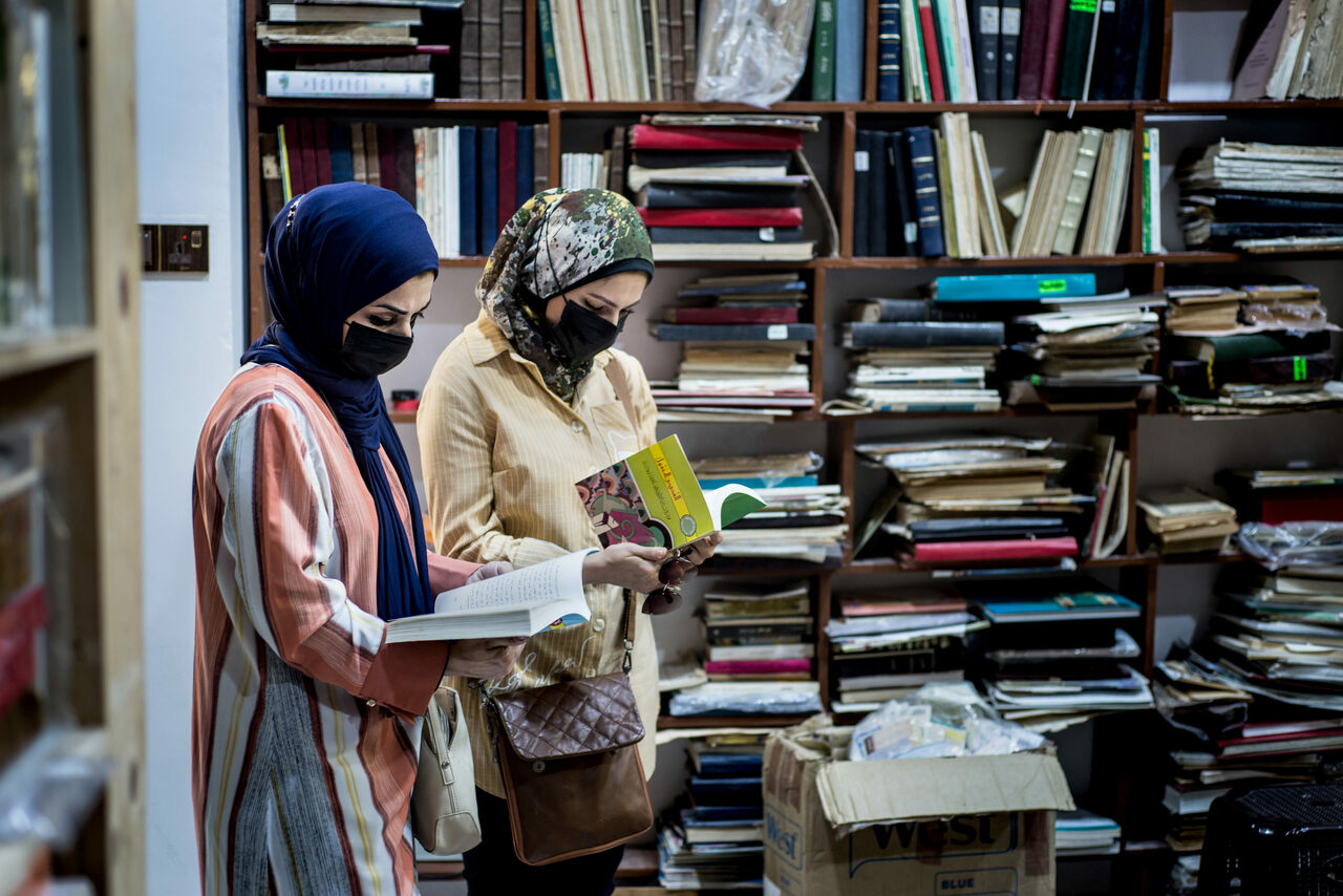 Customers return to Maktaba al-Sham in Mosul's Old City. Shopping for books on Najafi Street is a tradition that dates back more than a century.