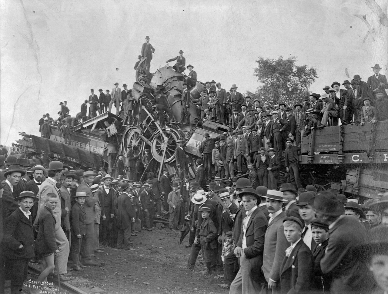 A crowd swarms over the wreckage to claim souvenirs in Buckeye Park in Ohio after a staged train wreck in 1896.