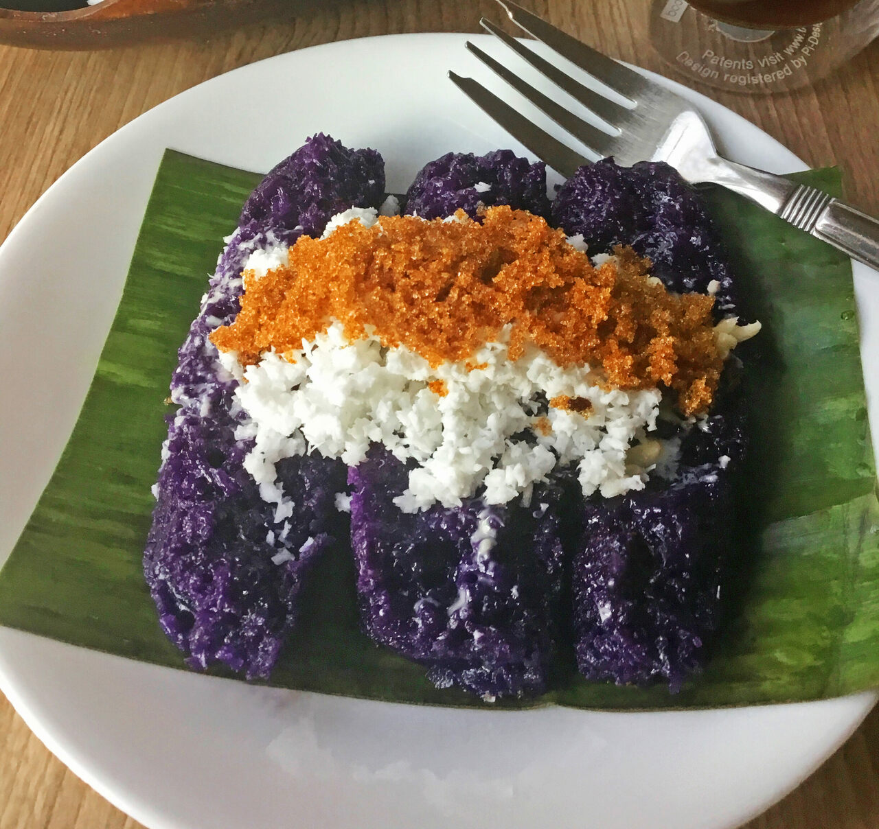 The purple hue traditionally comes from pirurutong rice, but cooks often use ube flavoring for color.