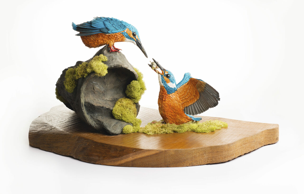 "In ""The Mating Proposal,"" a male common kingfisher offers fish to a female. This is the most complex sculpture Rajput has built so far."