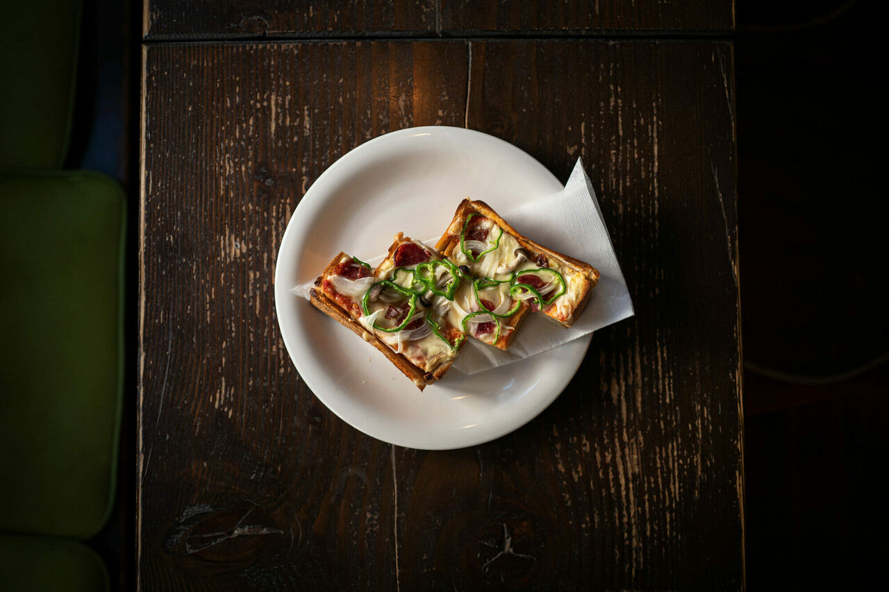Overhead view of kissa Bugen's well-designed and engineered pizza toast.