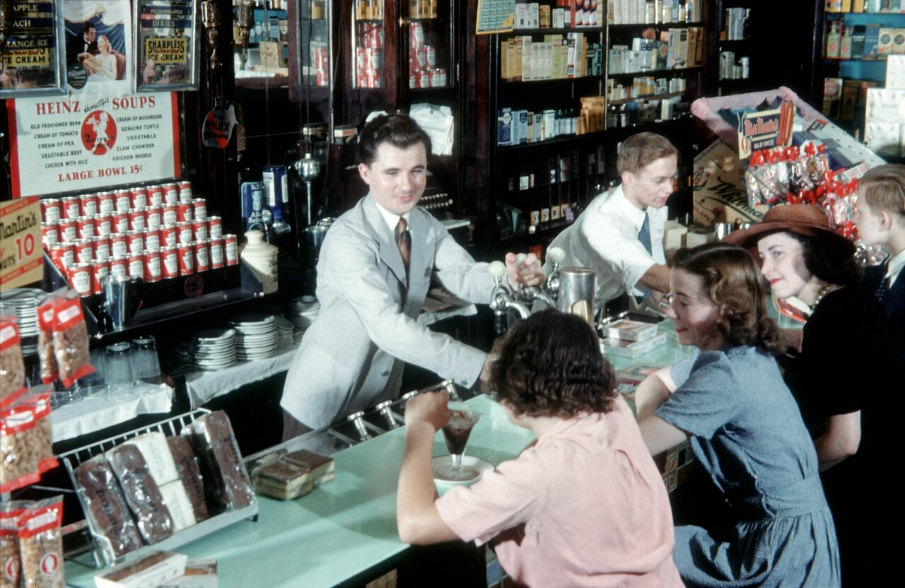 A Pharmacist works the soda fountain at the Clayton & Edward Chemists and Pharmacy in New York City, circa 1948.