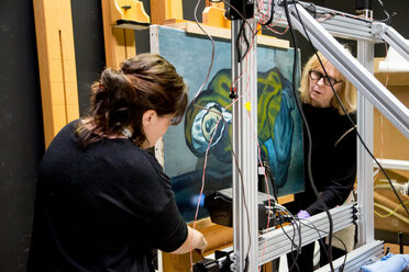 Emeline Pouyet of Northwestern University (left) and Sandra Webster-Cook of the Art Gallery of Ontario set up the painting for an X-ray fluorescent scan.