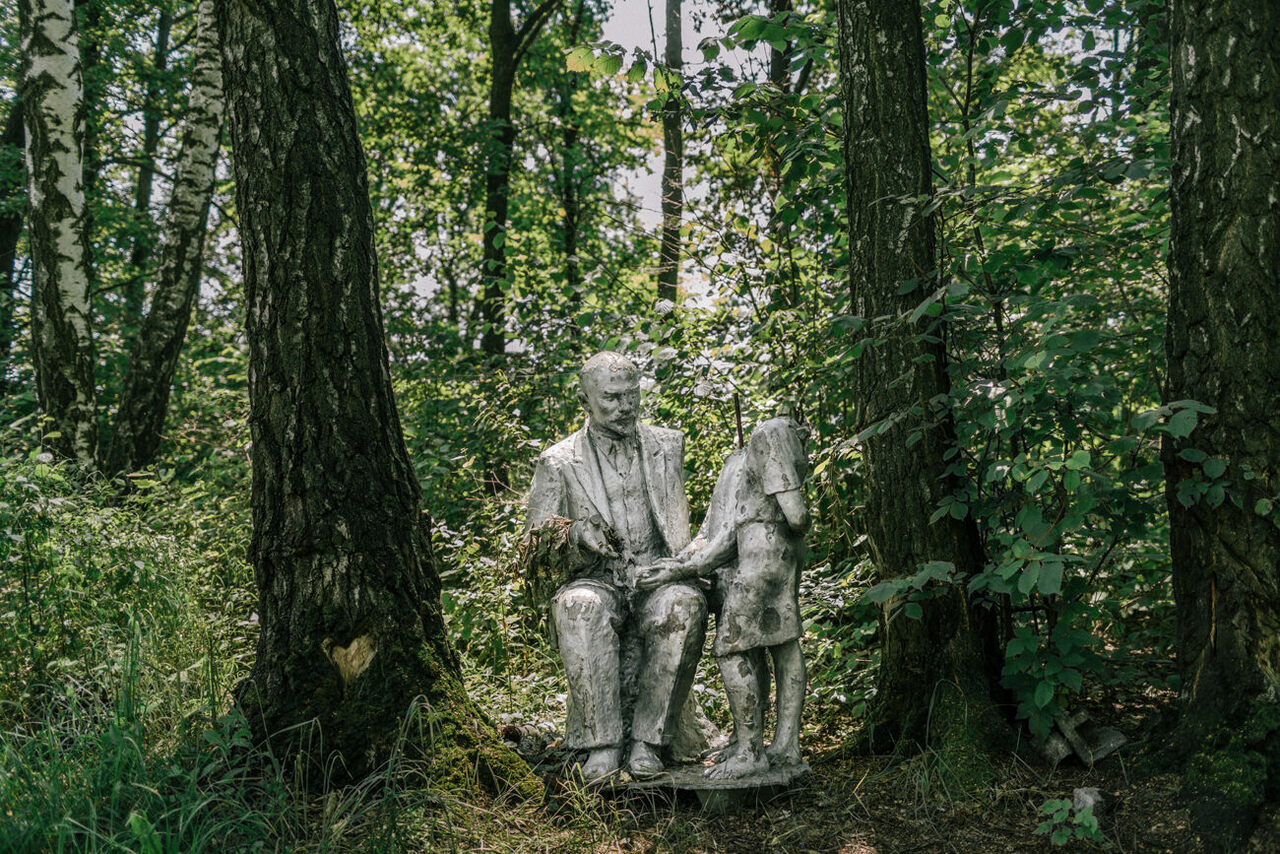 "A Lenin monument hidden in a forest. The mayor explained ""It's the last one in the region, and we never know what the next government will be like."" Local youths built a table next to it that is now a popular gathering place. Horbani, Kyiv Region, July 2016."