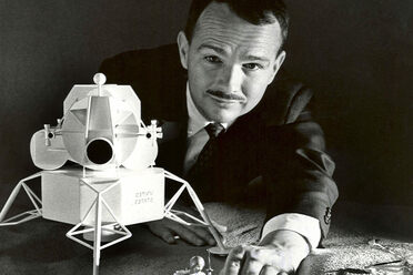 Eugene Shoemaker looking over a lunar lander model of his own making.