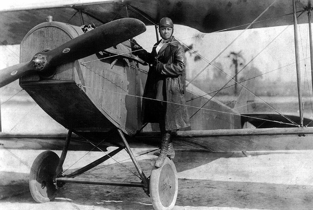 Bessie Coleman and her biplane in 1922.