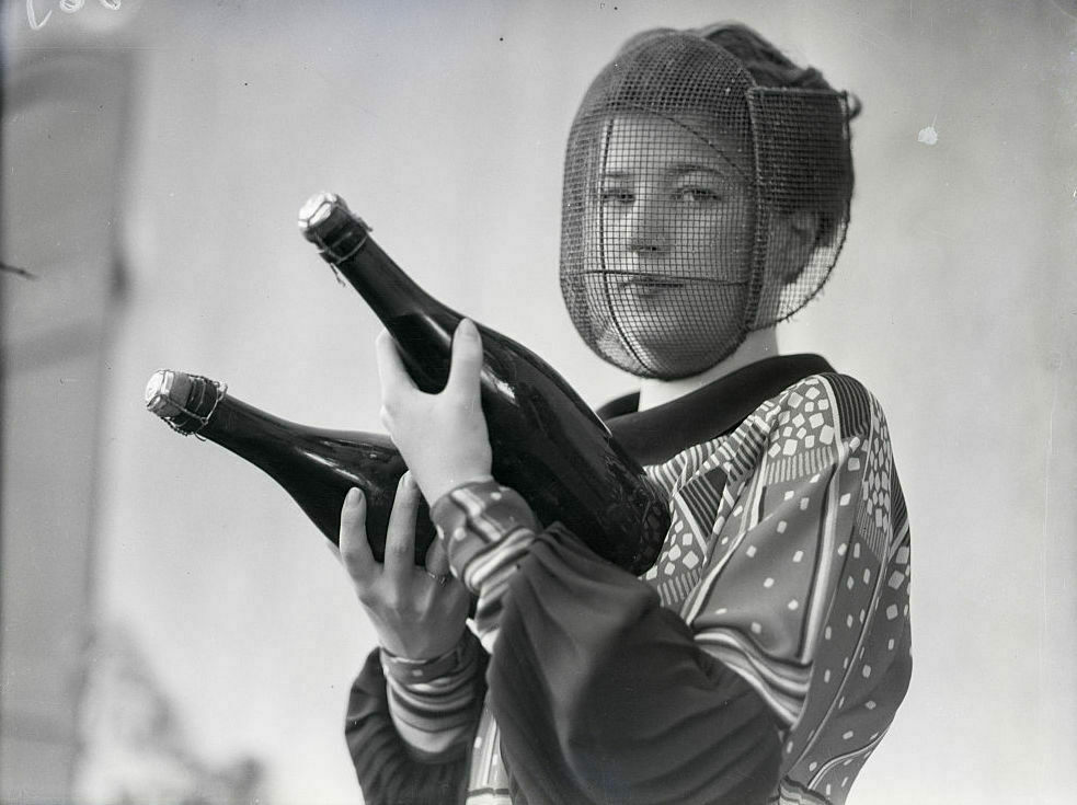 This Champagne inspector wears a mask to protect her face from shattering bottles.