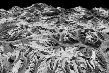 Oblique view of Himalayan landscape captured by a KH-9 HEXAGON satellite on December 20, 1975, on the border between eastern Nepal and Sikkim, India.