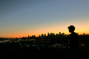 Hendrik watches the sun rise over the city that never sleeps