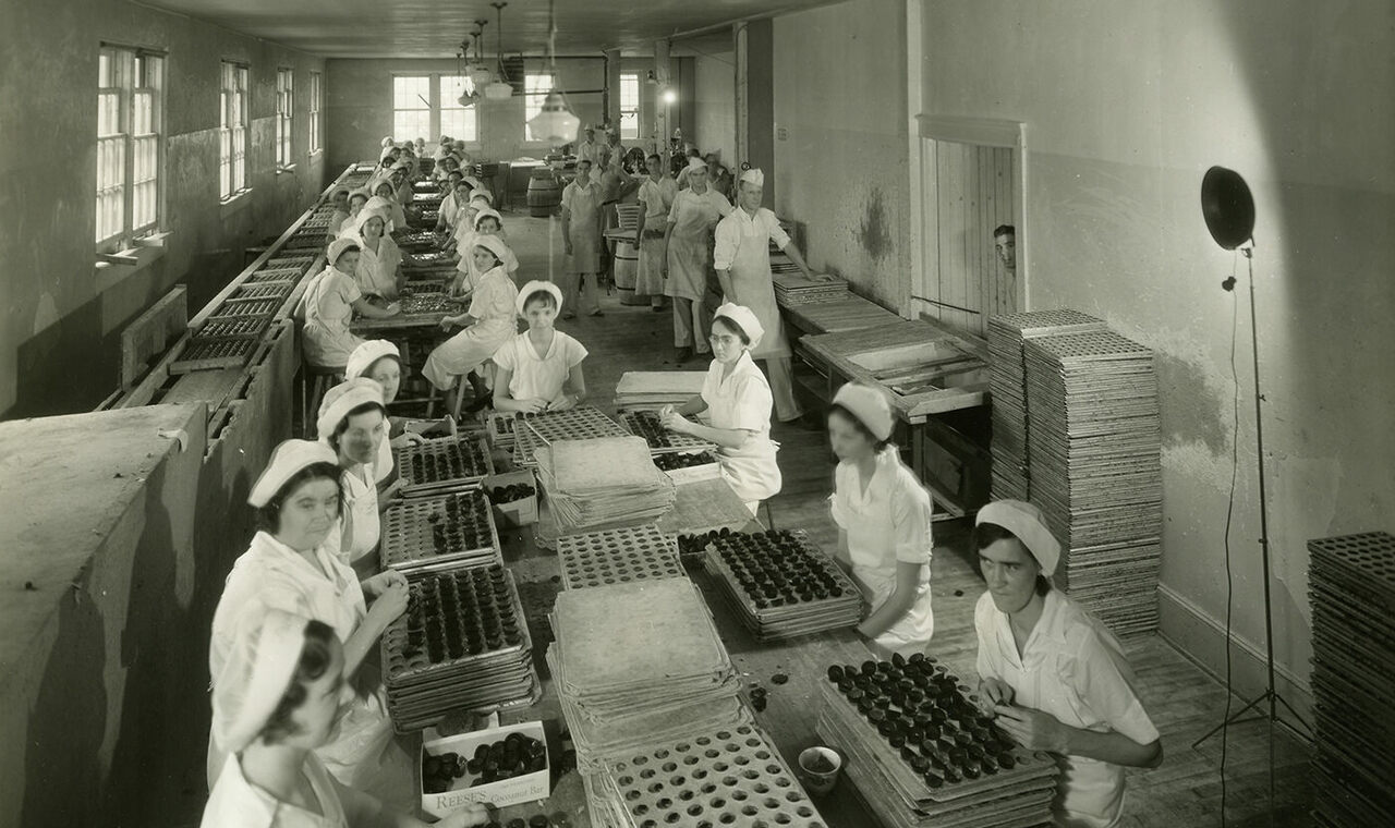 The cupping and hand dipping room for Reese's Peanut Butter Cups, c. 1935.