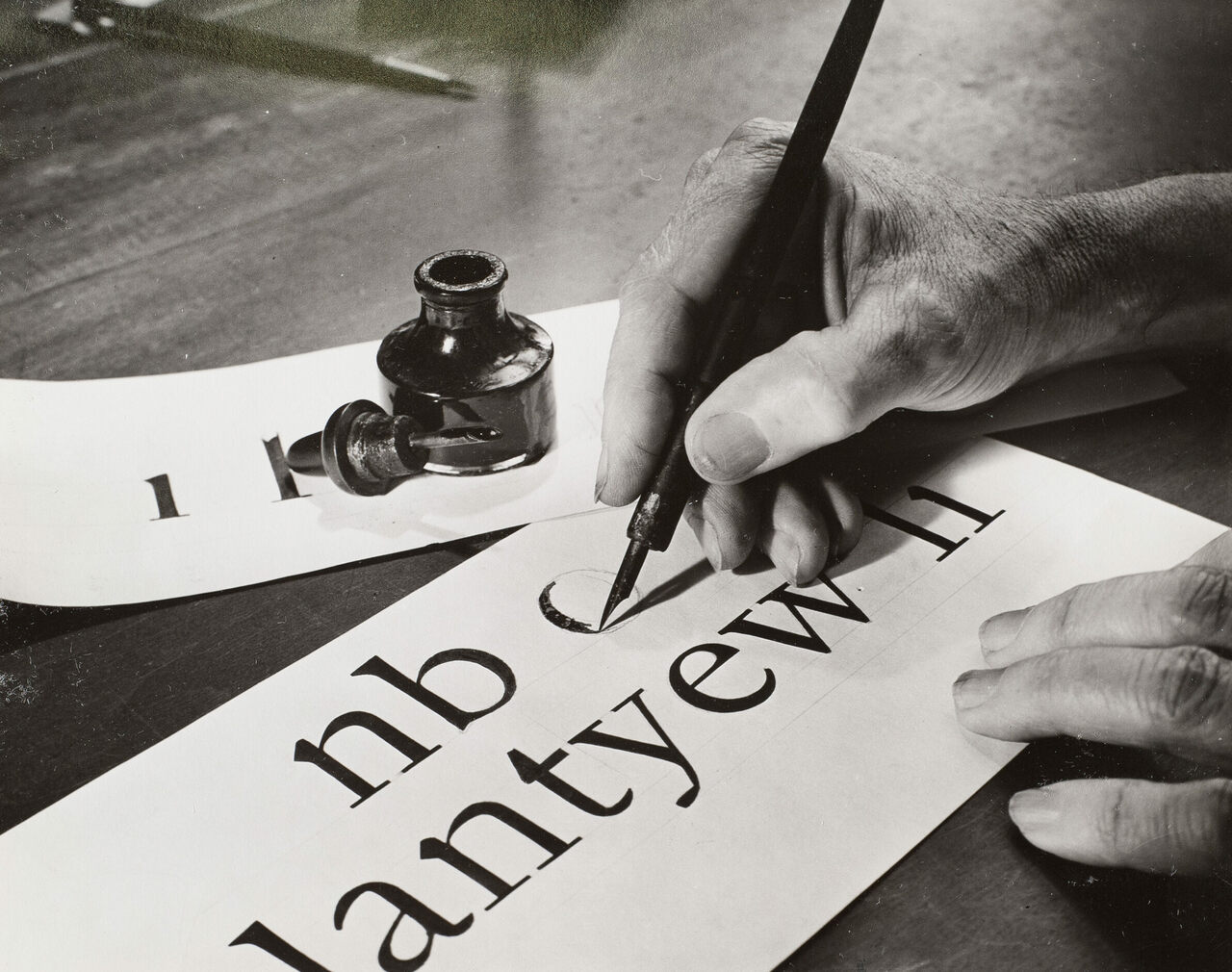 W.A. Dwiggins, hand-drawing letters in 1941.