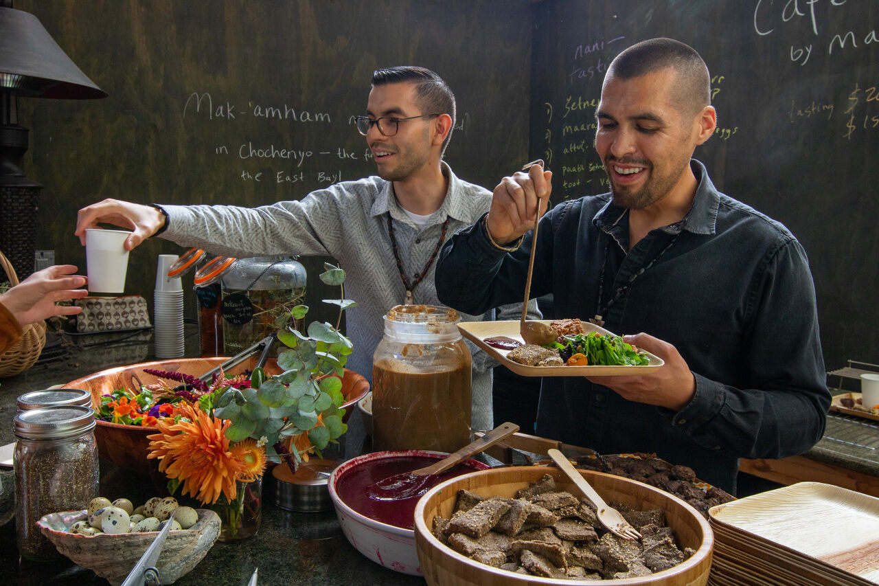 Louis Trevino (left) and Vincent Medina (right) get ready to serve a meal in the Ohlone Cafe.