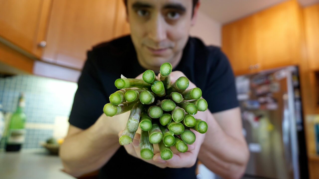 Pelling in the kitchen with asparagus, the veggie that inspired his work on spinal cord injuries.