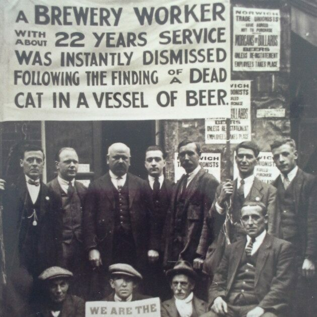 Striking brewery workers protesting the unfair firing of a coworker.