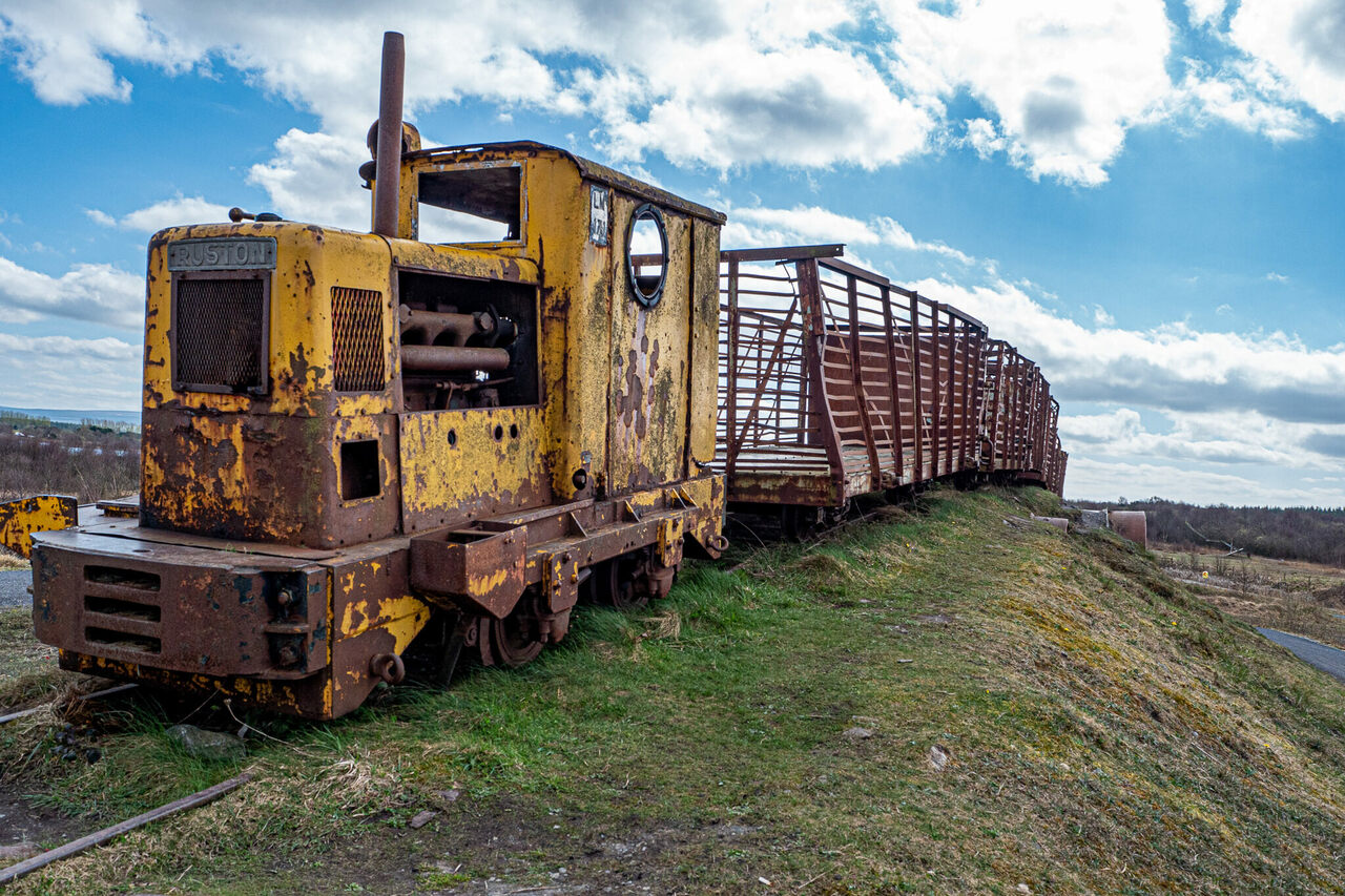 This rusting yellow train is a 1950s-era piece of industrial mining equipment which has found a new life as the iconic entry sculpture to Lough Boora Discovery Park.