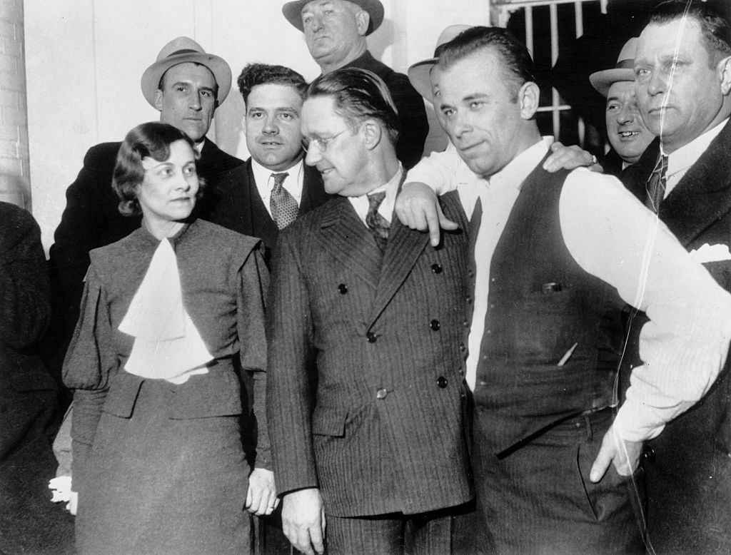Dillinger (right, in vest) was notoriously charismatic, even when surrounded by cops.