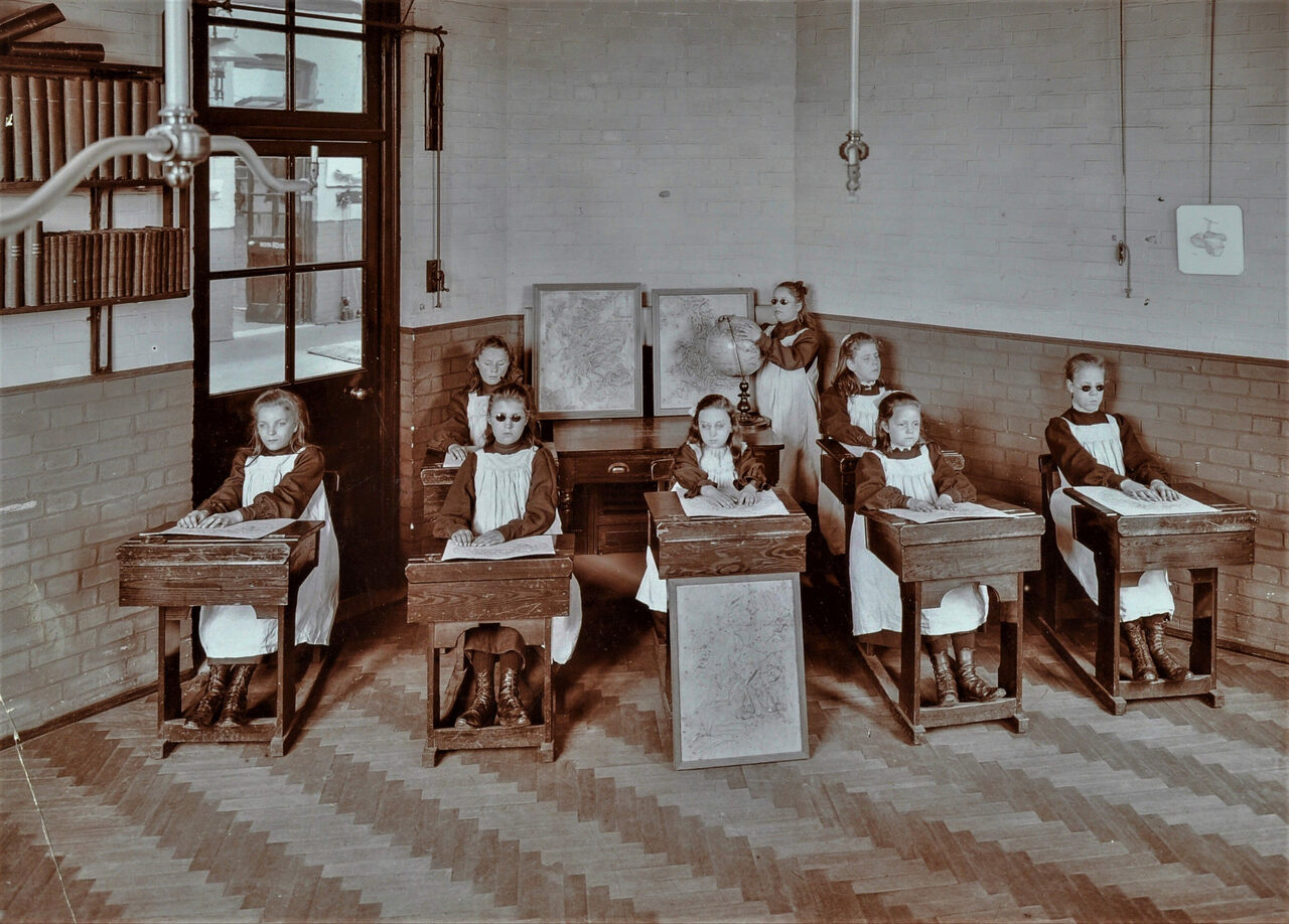 A geography lesson at the Elm Lodge Residential School For Elder Blind Girls, in London, in 1908.