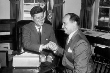 John F. Kennedy and Chep Morrison share a slightly awkward handshake in 1961.