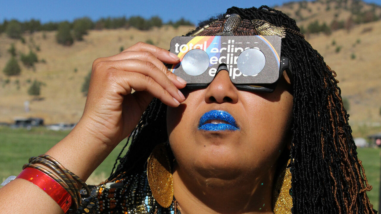 Tara Middleton, of Sun Ra Arkestra, looked radiant in custom eclipse viewing glasses.