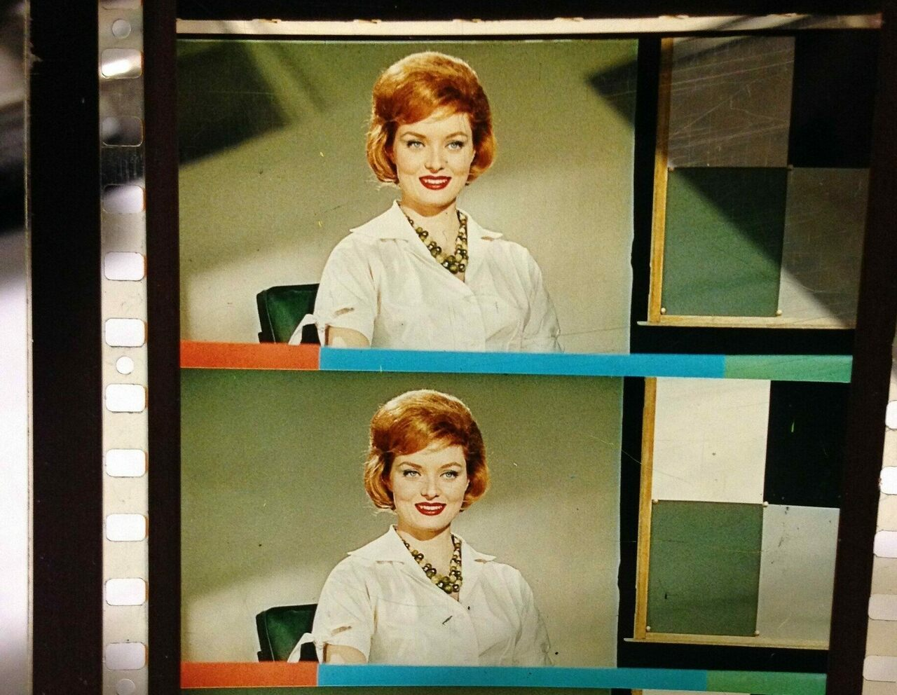 The format here is from a 70mm print, wide enough for her red bouffant.