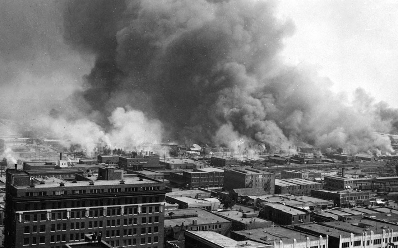 Smoke billows over Tulsa, Oklahoma, during the 1921 Tulsa Race Massacre.
