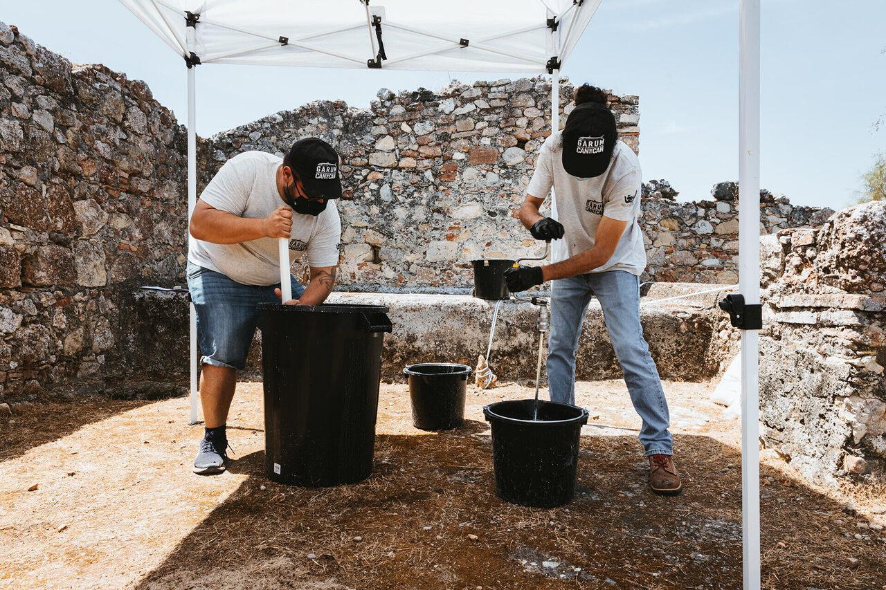 The team mixes salt and seawater to make brine.