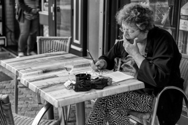 A different lady filling out a different crossword.