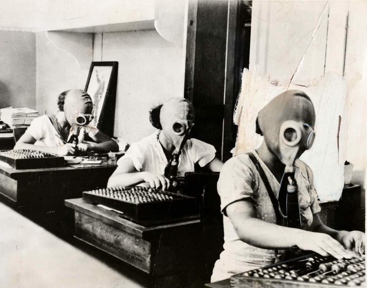 Bookkeepers prepare for a gas attack in Odessa, Russia, 1935.