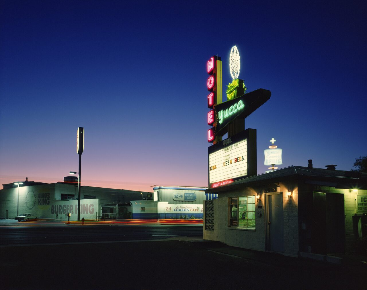 Some motels, like this one with a big yucca plant on its sign, referenced desert sights.
