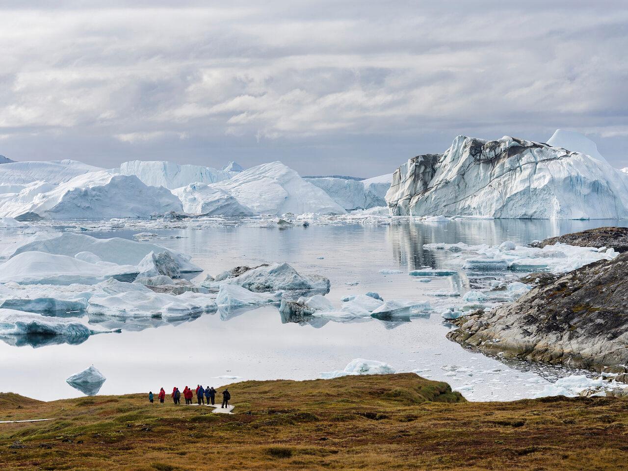 Tourists admiring the Ilulissat Icefjord.