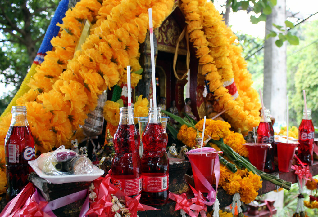 Gods and spirits are offered flowers, food, and Fanta.