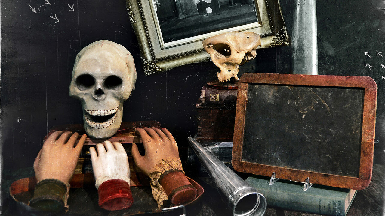 A collection of props for a medium, including a talking skull, rapping hands and a slate to record ghostly visits.