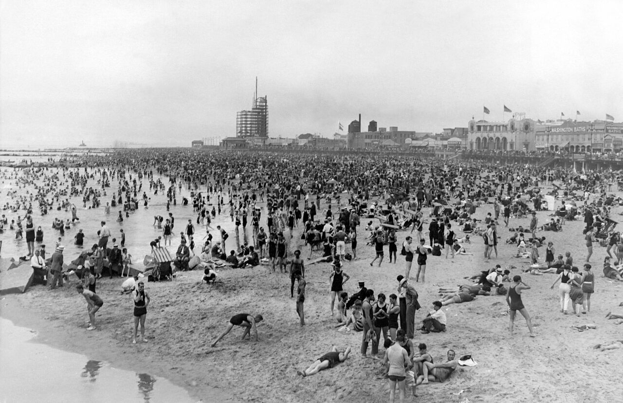 The beach at Coney Island, with the Washington Baths peeking out in the distance.