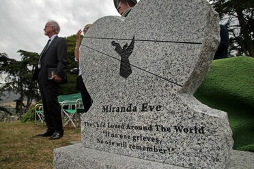 "The gravestone for ""Miranda Eve,"" the mysterious mummified girl from 1876; the headstone was updated with her information once she was identified."