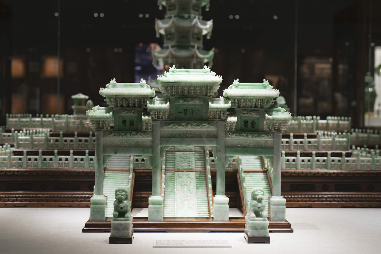 A separate gateway stands 16 inches tall in front of the pagoda, along with two guardian lions.