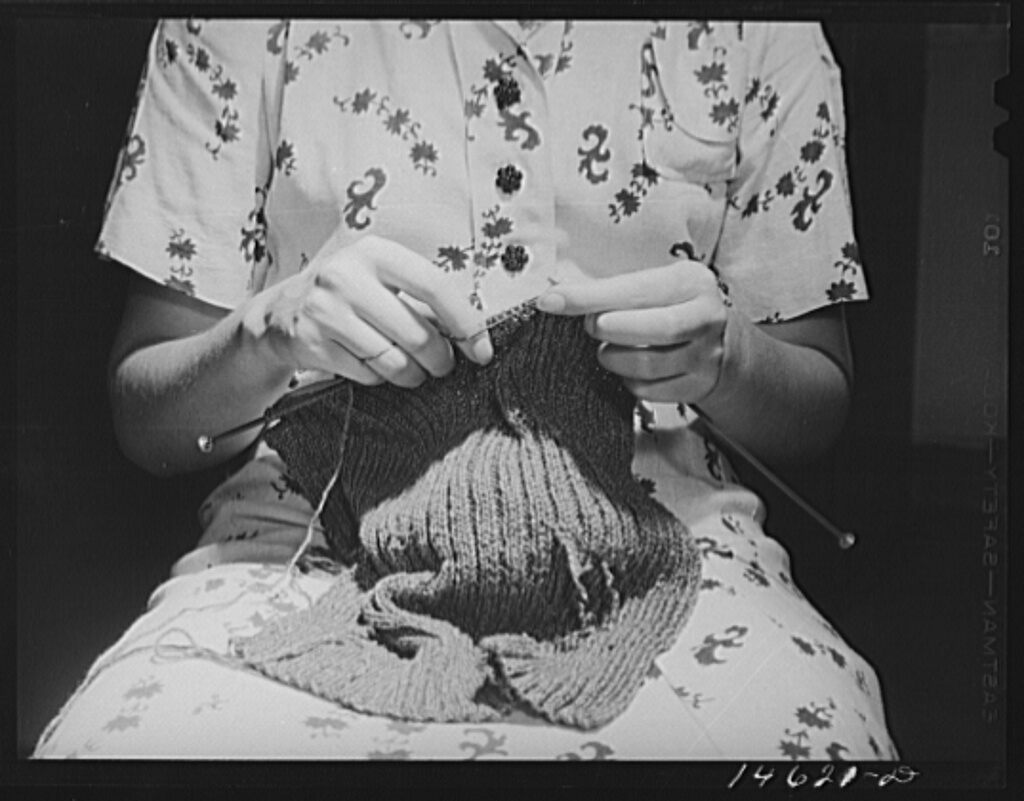A woman knitting, Washington DC, 1941.