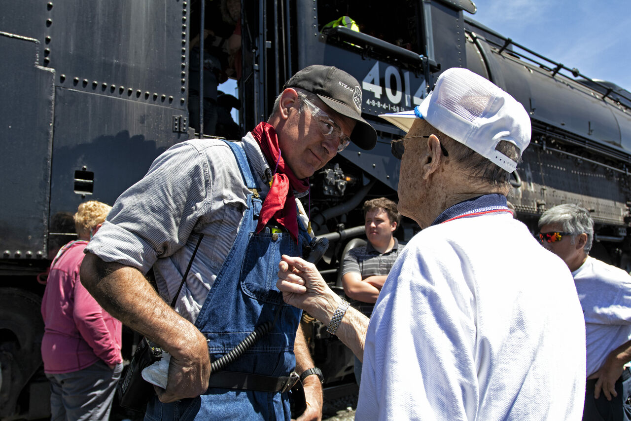 Ed Dickens (left) speaks with Merrill Transtrum (right), who drove the Big Boy in the 1940s and 1950s.