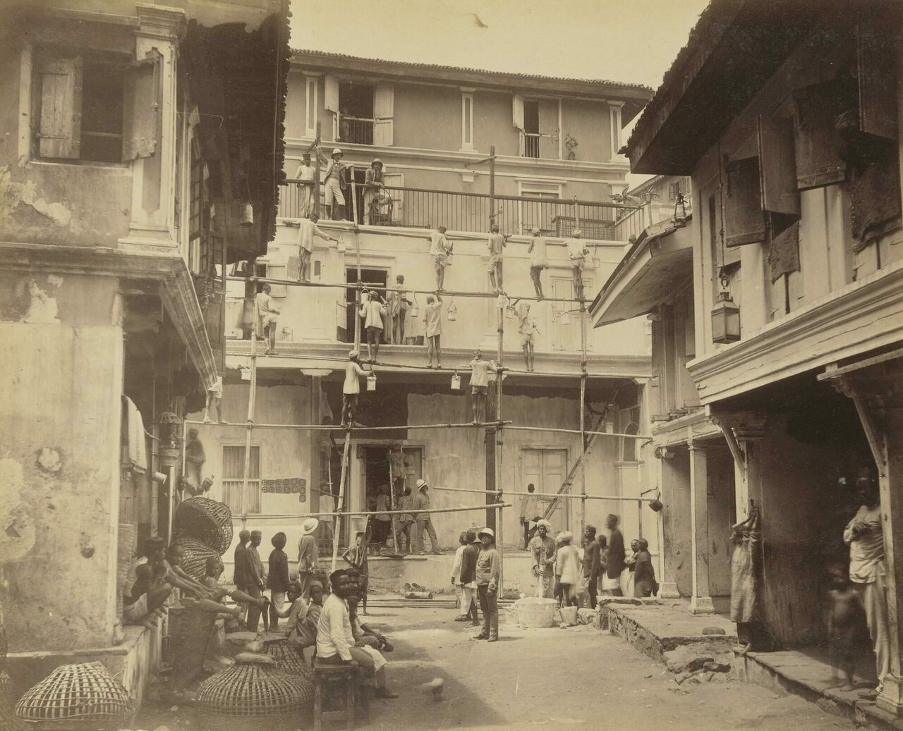 Workers clean a house in a neighborhood affected by the 1896 bubonic plague.