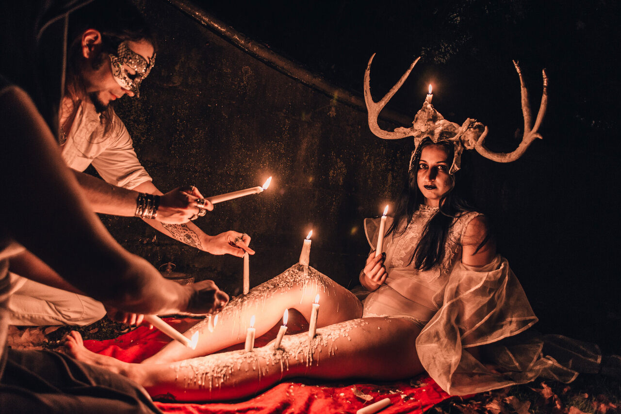 Living candelabras sat or stood unflinching as hot wax dripped onto their bodies, forming incredible sculptures and shapes.