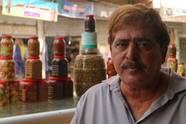 Mashood Shah Faheem inherited his father's <em>achaar</em> (pickle) shop.